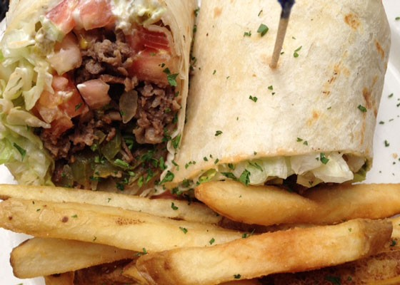 A Philly wrap with grilled sirloin, jalapeno cream cheese, tomatoes, lettuce and green peppers. | Nancy Stiles