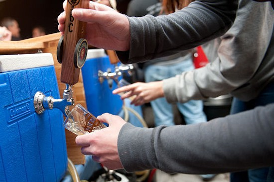 Pouring Urban Chestnut at Microfest 2014. - JON GITCHOFF