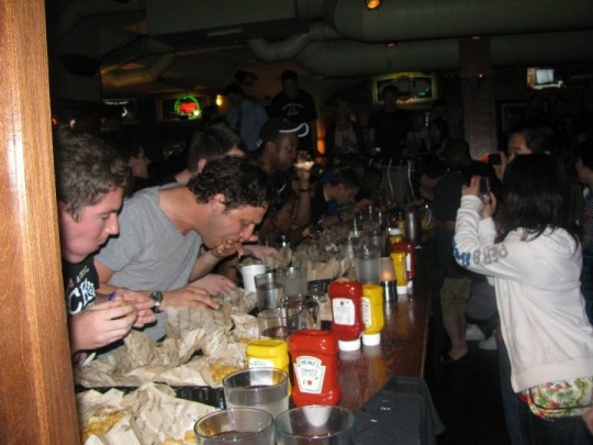 Last year's tater tot eaters chow down. - COURTESY OF BAR LOUIE