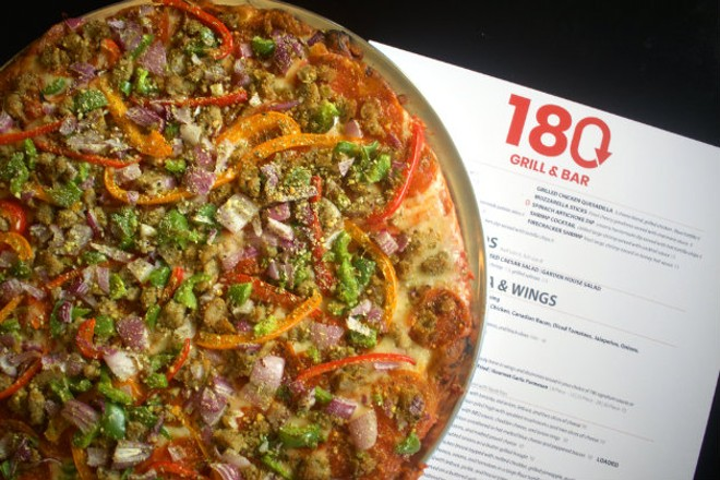 The St. Louis-style pizza is cooked in a brick oven to ensure a crispy crust. - CHERYL BAEHR