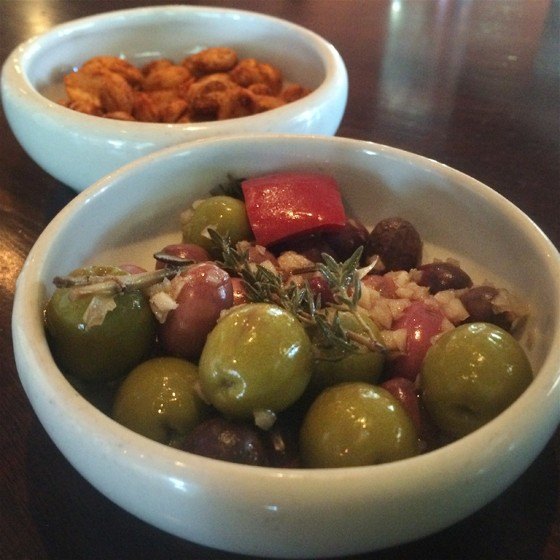 Modesto's marinated olives and spiced Marcona almonds. | Patrick J. Hurley