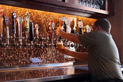 Pouring a beer at the new Flying Saucer   Kaitlin Steinberg