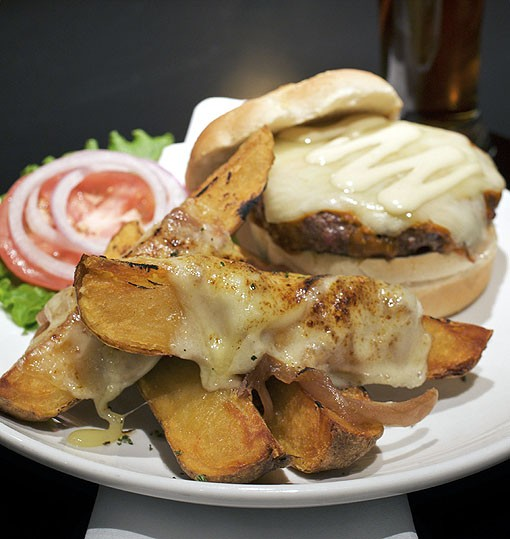 The buffalo-style burger is grilled and basted with a house sauce, Monterey Jack cheese and a house mayonnaise. And is shown here with French Onion steak fries, which Jeff tells us has not been a regular offering, but after this photo shoot, will probably become one. See more photos from inside Hanley's in this slideshow. - PHOTO: JENNIFER SILVERBERG