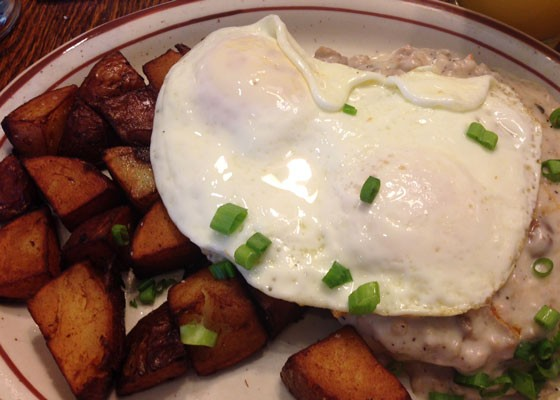 Country fried steak topped with gravy and two eggs, plus home fries. | Nancy Stiles