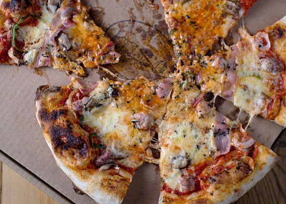 Provel-covered pizza at Basso. | Jennifer Silverberg