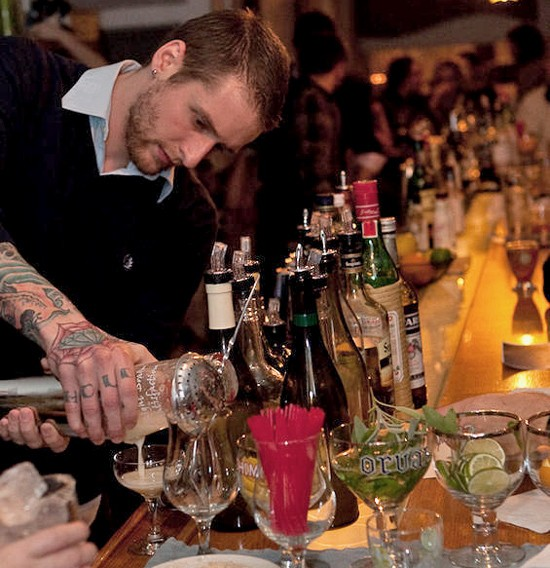 Eclipse bar manager Lucas Ramsey plies his trade at a 2009 cocktailin' event. - STEW SMITH