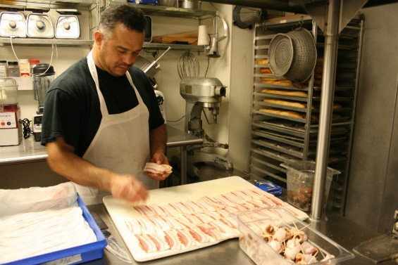 Dinsmoor's other assistant, Jesus Garcia, preps bacon-and-date wraps. - CHRISSY WILMES