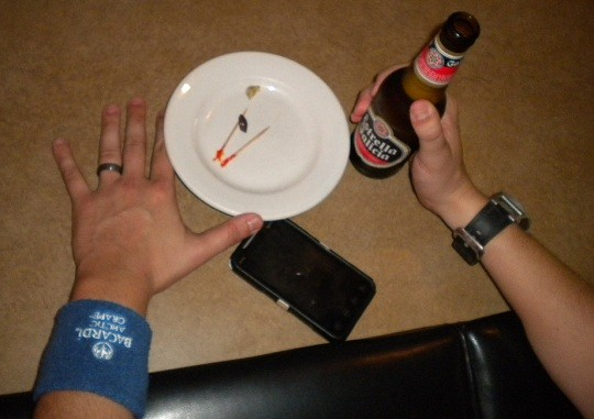 Hurricane and his uber-cool wristband unwind with a cerveza. - DEBORAH HYLAND