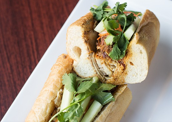 """Porkapocalypse"" banh mi sandwich with pickled daikon, carrot, cilantro, cucumber and togarashi mustard."