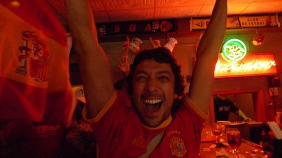 Javier Mendoza goes loco after Spain's winning goal. - PHOTOS BY KEEGAN HAMILTON