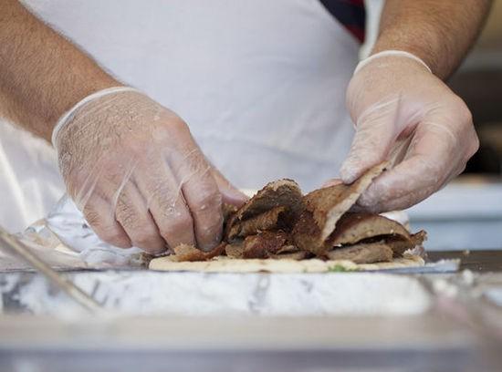 Making the classic beef and lamb gyro. - JENNIFER SILVERBERG