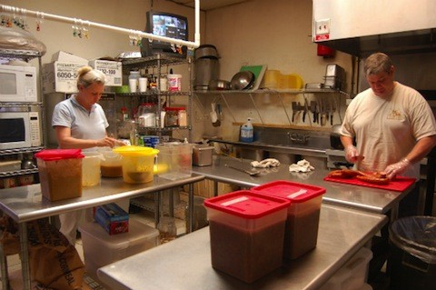 Owners Holli and Jon Rercher in the Gumbo Shop kitchen | Ettie Berneking