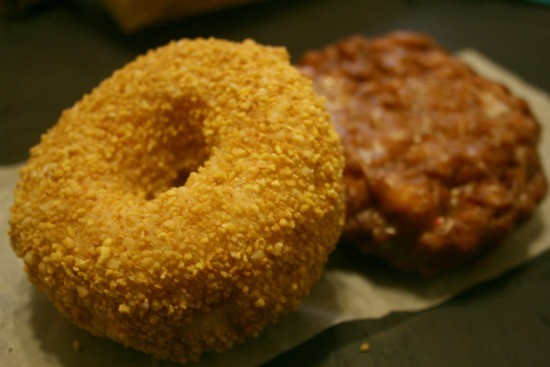 An apple fritter and cream-filled toasted coconut donut from Donut House. - CHRISSY WILMES