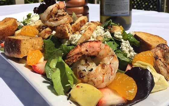 The new signature salad topped with strawberries, mandarin oranges, gorgonzola, artichokes, pecans and a strawberry vinaigrette. | Vito's