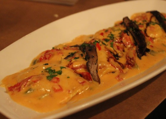 Seafood ravilio with sherry wine, sun-dried tomato, trinity of pepper in a tomato cream sauce and garnished with roasted portobello mushrooms with a balsamic reduction. | Nancy Stiles