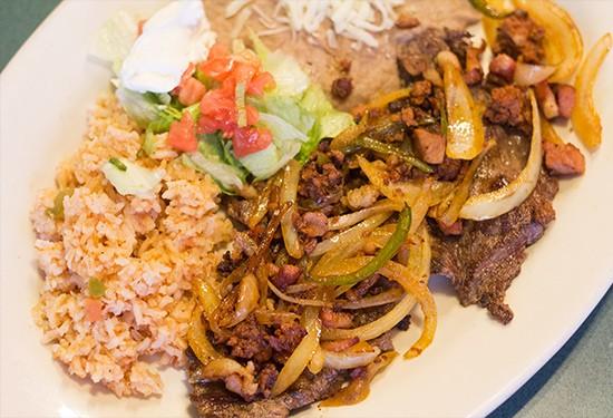 """Steak Ranchero"" with onions, chorizo, bacon, rice and beans."