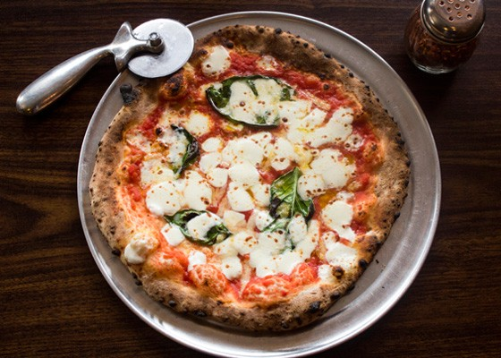 The classic Margherita, with fresh tomato sauce, fresh mozzarella, fresh basil, hand-grated Parmesan and extra virgin olive oil.   Mabel Suen
