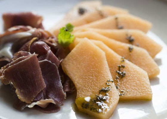 Prosciutto de Parma and melon slices, white balsamic reduction and mint oil. | Jennifer Silverberg