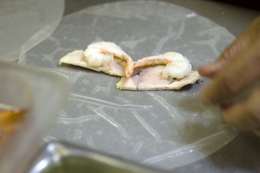 Start with shrimp on the rice paper -- and don't forget the pork.