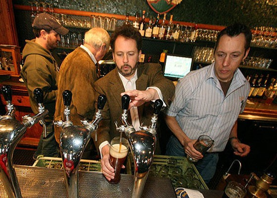 Schlafly co-founder Dan Kopman gets a pour at the brewery's 18th birthday party. | Nick Schnelle