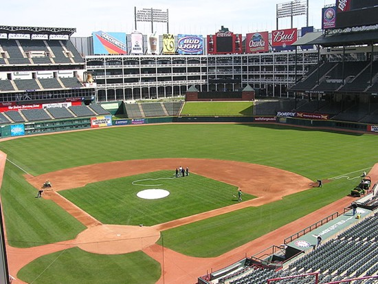 Bored? Busy yourself counting the World Series pennants flying above the Rangers' home park. - IMAGE VIA