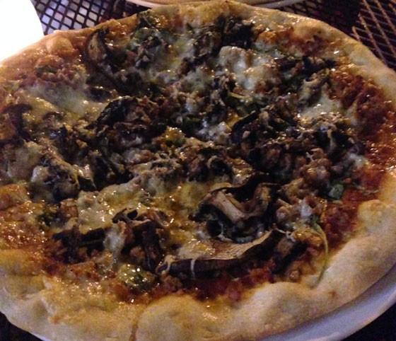 Sausage pizza with arugula, portobello mushrooms and fontina.   Nancy Stiles
