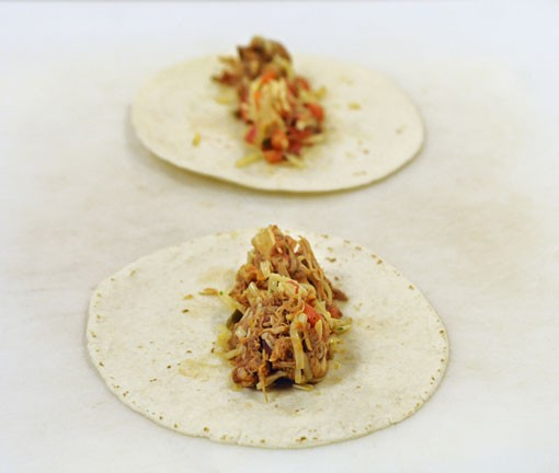 Place the chicken mixture on the tortillas. See more photos. - PHOTO: JENNIFER SILVERBERG
