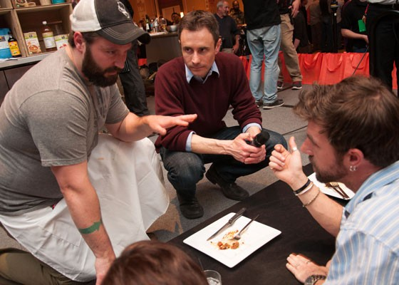 Chef Ed Heath, with RFT editor-in-chief Chad Garrison, presents his dish to the judges. | Micah Usher