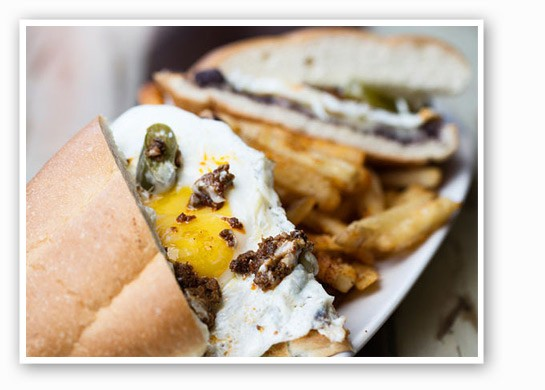 Mission Taco's Chorihuevo torta with chorizo, fried egg, pickled jalapeno, smashed black        beans, Chihuahua and garlic lime mayo. | Jennifer Silverberg