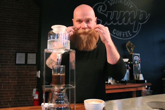 Scott Carey, the man behind the plan at Sump Coffee, with a Kyoto drip brewer. - MABEL SUEN