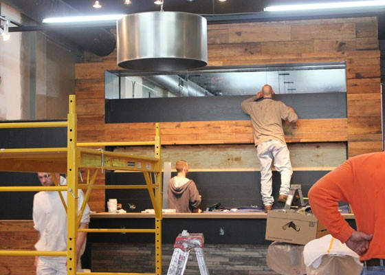 The wood behind the bar was reclaimed from Green Bean, which formerly occupied the space. | Nancy Stiles