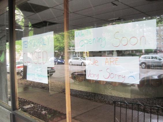 The signs in the window of Kampai - IAN FROEB