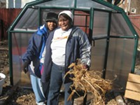 Ernestine Isaiah and Bobbie Sykes clean out the greenhouse to put down compost. - PHOTO BY KRISTEN HINMAN