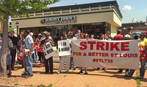 Protesters gather outside Jimmy John's in Soulard yesterday. More strikes are scheduled for today.