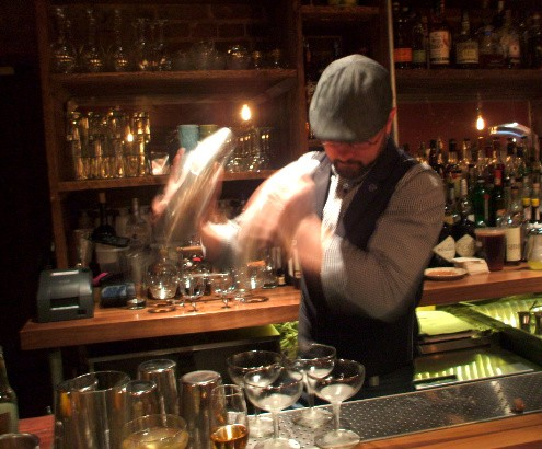 Chad George of Demun Broadway Oyster bar gives his drinks a good shake during the signature ingredient round. - KRISTEN KLEMPERT