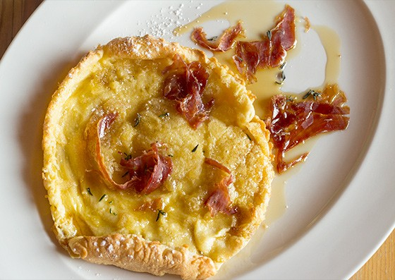 """Three Flags Tavern's """"Dutch Baby"""" with ham and maple syrup. 