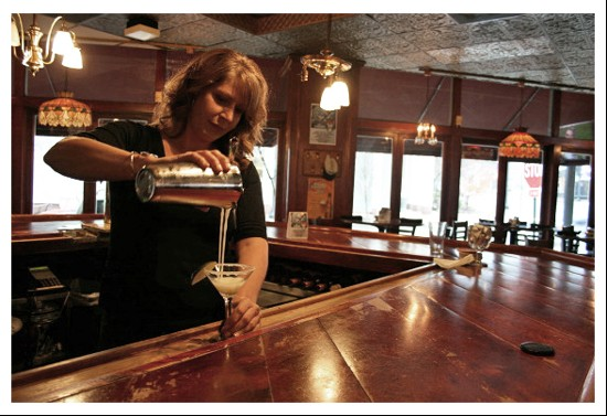 C.J. Muggs bartender Melissa Pfeiffer gracefully pours a key lime martini. - CHRISSY WILMES