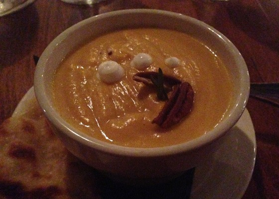 Butternut squash soup with toasted pecans and sour cream. | Nancy Stiles