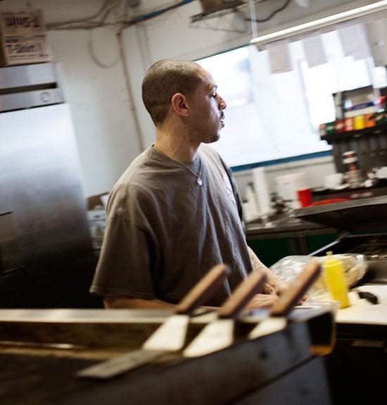 Owner Anthony Ellerson Jr. at work in the kitchen of the Kitchen Sink. - JENNIFER SILVERBERG