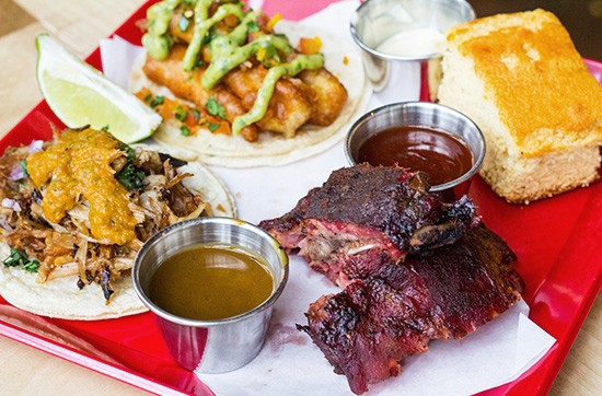 """Spare No Rib's """"SNR Plate"""" with two ribs, carnitas and fish tacos and cornbread. - PHOTOS BY MABEL SUEN"""