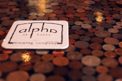 The bar top has coins from all over the world set into the epoxy. - CAILLIN MURRAY