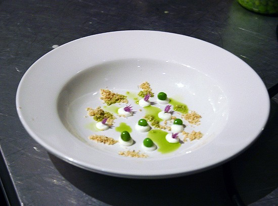 Niche's English pea soup conceals lavender brioche soil, goat cheese, blanched peas and chive blossoms. - KATIE MOULTON