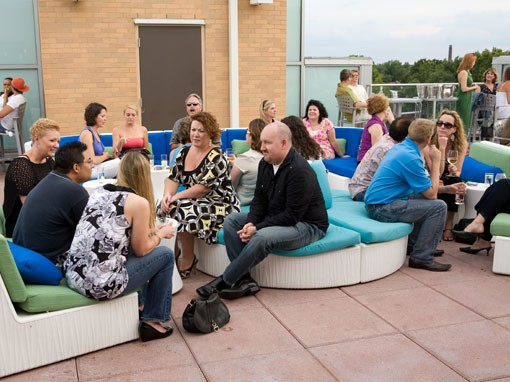 A crowd gathers at the Rooftop Bar at Moonrise Hotel on July 20 for a 40th anniversary party, commemorating the Apollo 11 moon landing. - PHOTO: STEW SMITH