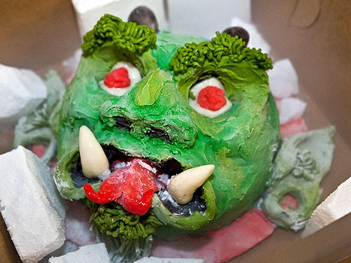 Soraci's favorite cake, the Green Devil, is made from peanut butter and chocolate cake, with green- and red-dyed white-chocolate ganache. The hair is made up of chocolate modeling paste. - PHOTO: STEW SMITH