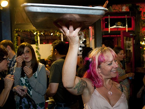 Kerry Soraci moves about the crowd with samples of her cakes. - PHOTO: STEW SMITH