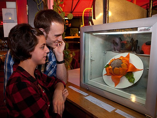 A couple discusses the intricacies of the sunflower cake. - PHOTO: STEW SMITH
