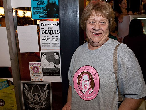 Kerry's mom, Charlotte Soraci, sporting her daughter's company logo, came for support and ended up being put to work collecting admission at the door. - PHOTO: STEW SMITH