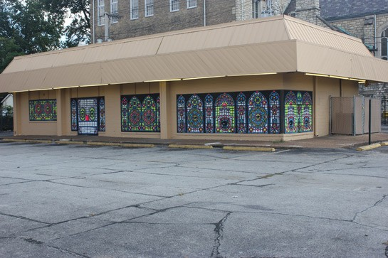 The mural on the former Church's Chicken building.   Nancy Stiles