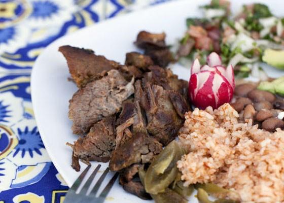 Guanajuato style carnitas: pork shoulder, jalapeno chiles, pico de gallo, and guacamole. Served with beans, rice and tortillas. | Jennifer Silverberg