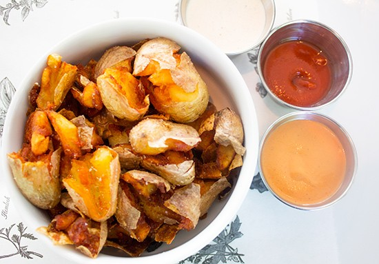 Crushed fried fingerling potatoes with house dipping sauces.